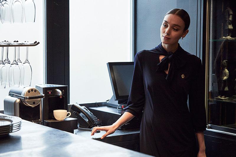 Hotel front of desk wearing bespoke pussy box dress uniform