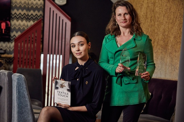 Bespoke Textiles founder Katie Young Gerald with awards and The Textile Touch book