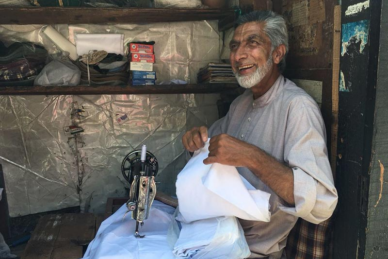 Indian man sewing cashmere in Kashmir