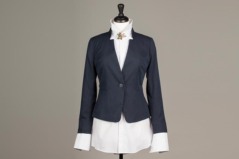 Bespoke blue uniform jacket with white shirt and bespoke brooch