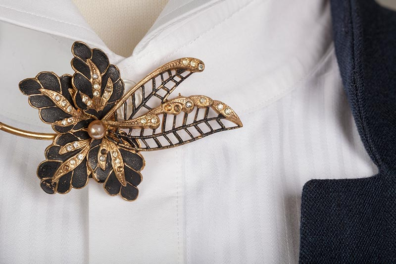 Gold and black uniform brooch