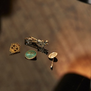 Tie clips and lapel pins
