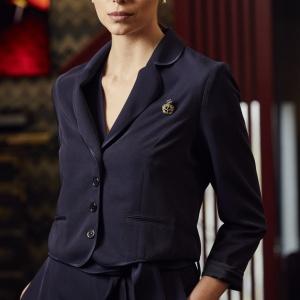 A model wearing a navy blue cropped blazer