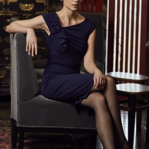 A model wearing a navy blue waterfall dress