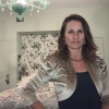 A cream bolero jacket modeled by Katie Young