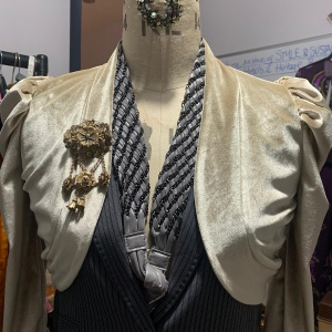 cream bolero jacket shown from the front on a mannequin