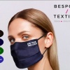 A model wearing a black face mask with a 4 colour option key