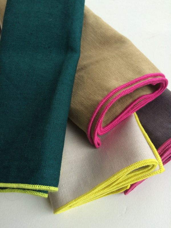 A selection of napkins, all 1 colour with a contrasting colour edge
